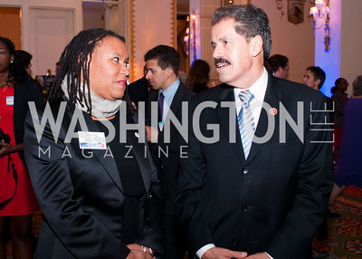 DC Vote executive director Kimberly Perry chats with Congressman Jose Serrano