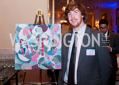 Mike Guy with a painting he made for DC Vote