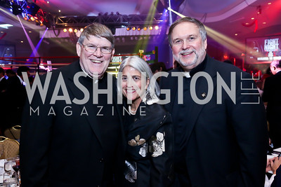Catholic Charities CEO Fr. John Enzler, Michela English, Fr. Steve Shafron. Photo by Tony Powell. 2013 Fight Night. Hilton Hotel. November 14, 2013