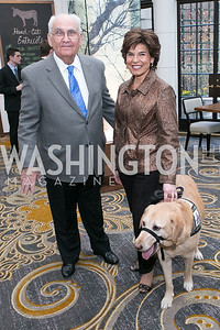 "John Underwood, Leslie Smith, with dog Issac. Gary Sinise Foundation and The Caucus Room Brasserie ""Inspiration to Action,"" fundraising dinner. Photo by Alfredo Flores. Westin Georgetown. March 20, 2013"