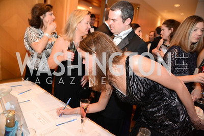 Erin Porch bids on the Silent Auction, Heroes Curing Childhood Cancer Gala, at the Four Seasons.  Saturday, February 23, 2013. Photo by Ben Droz.