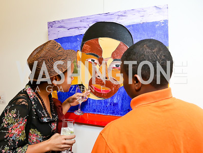 """Sunny Jolie and LPTM participant. Photo by Tony Powell. """"Courage on Canvas"""" Exhibit Opening. Pepco Edison Place Gallery. October 2, 2013"""