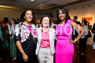 "Joyce Brayboy, Mary's Center President and CEO Maria Gomez, Kim Watson. Photo by Tony Powell. ""Courage on Canvas"" Exhibit Opening. Pepco Edison Place Gallery. October 2, 2013"
