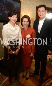 Maria Pica Karp (center), Mr. and Mrs. Gheewhan Kim, Minister for Economic Affairs, Embassy of the Republic of Korea.,  Open House and Review of Inaugural Parade for President Barack Obama.  Willard Intercontinental Hotel, Washington Suite, 10th Floor. Hosted by Lisa Barry, VP and Governmental Relations Manager, Chevron.  Photo by Ben Droz.