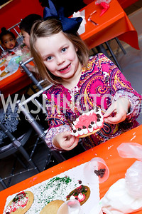 Catie Poersch. Photo by Tony Powell. A Holiday Cookie Party. Share Our Strength Headquarters. December 14, 2013