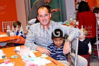 Jason Denby and Isaac Figini. Photo by Tony Powell. A Holiday Cookie Party. Share Our Strength Headquarters. December 14, 2013