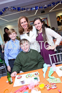 Pierce Anthony, Peter Connolly, Julia Farr, Cecilia Connolly. Photo by Tony Powell. A Holiday Cookie Party. Share Our Strength Headquarters. December 14, 2013