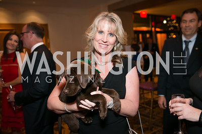 Vicki Meehas and Mojo the dog. Photo by Alfredo Flores. Taste of the Stars for Starlight Children's Foundation. Four Seasons. November 23, 2013.