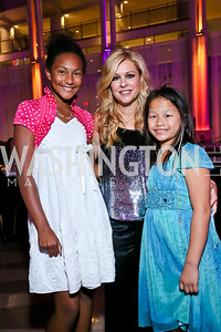 Chloe Tritchka Stuchell, Leigh Anne Touhy, Olivia Tritchka Stuchell. Photo by Tony Powell. WL CCAI 2013 Angels in Adoption Gala. Reagan Building. October 9, 2013