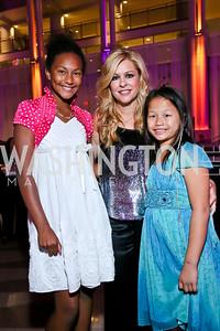 Chloe Tritchka Stuchell, Leigh Anne Touhy, Olivia Tritchka Stuchell. Photo by Tony Powell. WL CCAI 2013 Angels in Adoption Gala. Reagan Building. October 9, 2013