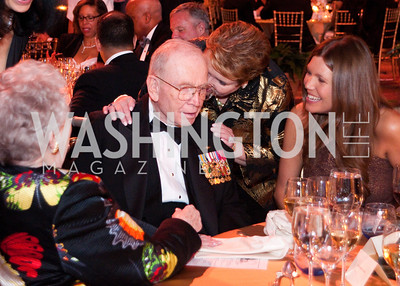 General P.X. Kelley listens to a friend as another smiles