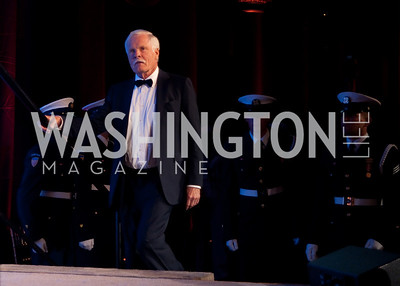 Ted Turner walks on stage to accept his award