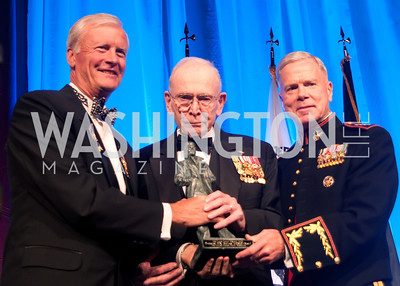 General P.X. Kelley accepts the Lone Sailor Award flanked by General John F. Amos and John Totushek