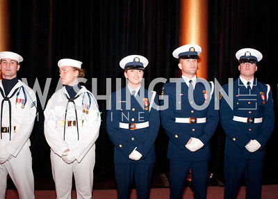 Navy personnel stand at attention