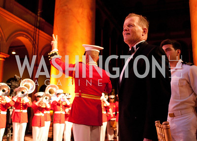 A patron smiles as the Marine Corps Band plays a tune