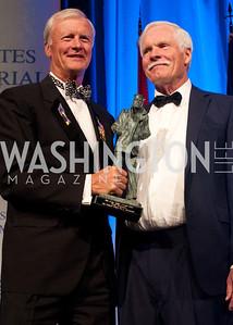 John Totushek hands Ted Turner his award