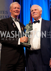 John Totushek hands Ted Turner his award