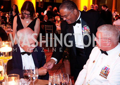 Ted Turner is handed a keepsake by a Navy officer