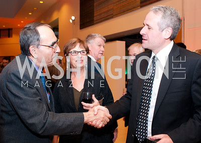 El Salvador ambassador Rubén Zamora shakes WOLA senior accociate Adam Isacson's hand
