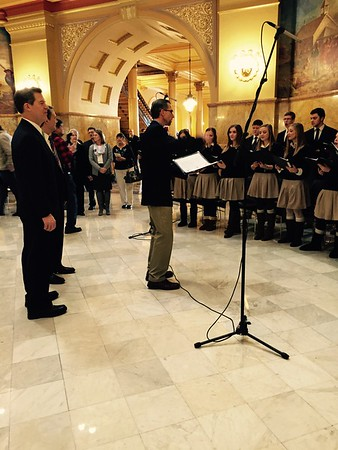Photo by Lexie Wasinger '15Following the inauguration ceremony, Gov. Sam Brownback and Lt. Gov. Jeff Colyer '78 listen to the TMP-Marian singers