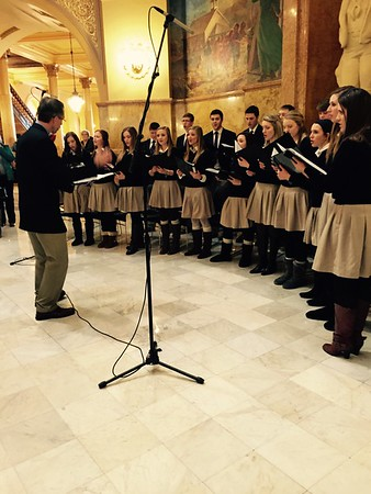Photo by Lexie Wasinger '15TMP-Marian singers lead attendees in the Kansas state song, Home on the Range, during the inaugural ceremony