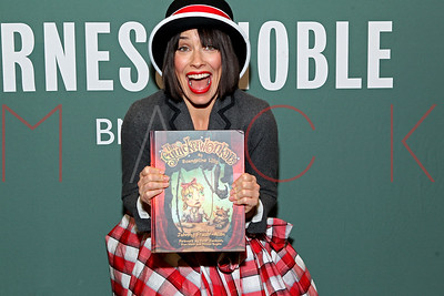 """NEW YORK, NY - NOVEMBER 17:  Evengeline Lilly signs Copies Of Her Book """"The Squickerwonkers Vol 1"""" at Barnes & Noble Tribeca."""