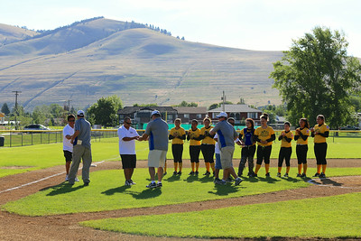 Oregon defeated Hawaii in Game 1 of the Western Region Senior Softball Tournament on July 25, 2014, in Missoula, MT. Umpiring were Dennis Cusick, Keith Evans and Scott Steinmetz.