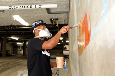 Demetris 'B.A.M.R.' Washington installed two murals at the Warehouse Artist Lofts – one on the exterior along 11th Street, and the other in the entrance to the underground parking garage. (Photo by Joan Cusick)