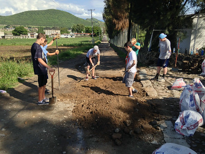 Participants working on the new road to help prevent flooding in the rainy season
