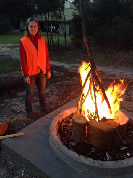 Tara Giess overseeing the lighting of the communal campfire.