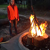 Tara Giess overseeing the lighting of the communal campfire.