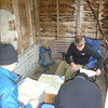 A good spot for doing maps - in Long Plain Hut out of the wind. Even the wood shed got used!