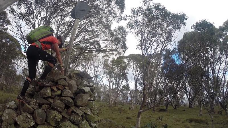 Laure Gauthiez Putallaz doing an unnecessary climb up Mt Nattung trig point.