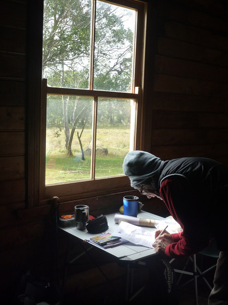 A good spot for doing maps - in Long Plain Hut out of the wind.