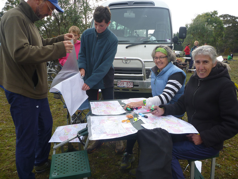 David Poland, Noah Poland, Llew Riley, Toni Brown and Carol Harding planning their routes and putting the finishing touches on maps.