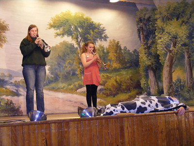 Leah Titus and Riley Cross Play Taps in honor of the dead cow