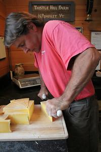 IMG_4993 JPG john putnam cuts cheese for sale