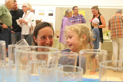 IMG_1445 JPG tessa westbrook and daughter aven,4, of pomfret look at glass blown by josh miller, crop to level