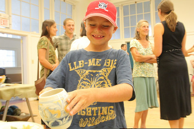 IMG_1538 JPG oliver sperry,8, looks at stoneware by veronica delay and jeff pentland