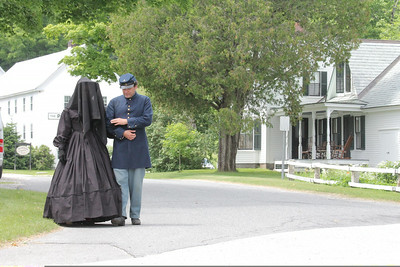IMG_7800 JPG laura and john peterson walk down main st past coolidge homestead