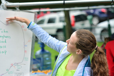 Claire Spangler looks over the course map