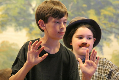 ABS' Oz Morse plays Harry Potter, left, and Ella Ballou looking into a cage