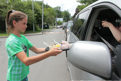 IMG_2014 JPG issy hiller,11, hands out samples of sorbet to drivers stuck in traffic from paving