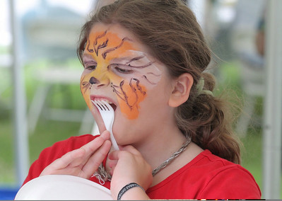 IMG_2095 JPG anya olmstead of bridgewater uses a fork to bring her tiger face to completion