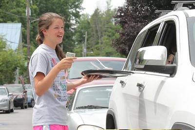 IMG_2005 JPG madeline hiller,13, gets a tip from a grateful driver stuck in paving traffic for a sample of sorbet