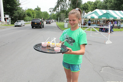 IMG_2020 JPG issy hiller,11, with samples of sorbet she was giving to drivers stuck in paving traffic jam