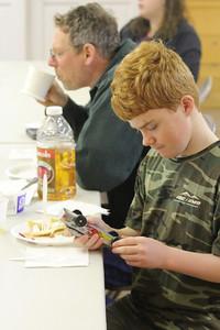 IMG_2059 JPG boy scout not cub dustin clarke fixes a wheel for a cub
