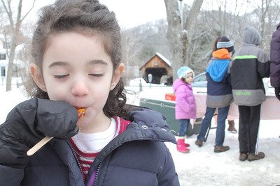IMG_3691 JPG lila coyne,4, of woodstock samples frozen syrup from snow