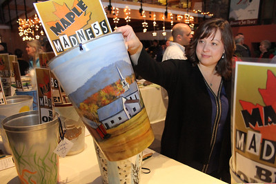 IMG_3911 JPG gail devine of woodstock looks at bucket painted by kitty O'Hara