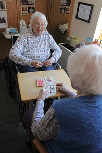 Playing cards with Mildred Gay of Mertens House